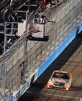 Nov. 7, 2008; Avondale, AZ, USA; Nascar Craftsman Truck Series driver Kevin Harvick takes the checkered flag to win the Lucas Oil 150 at Phoenix International Raceway. Mandatory Credit: Mark J. Rebilas-