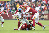 Landover, MD - December 9, 2018: Washington Redskins outside linebacker Ryan Kerrigan (91) tackles New York Giants running back Wayne Gallman (22) during the  game between New York Giants and Washington Redskins at FedEx Field in Landover, MD.   (Photo by Elliott Brown/Media Images International)