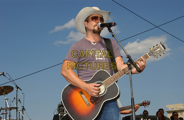 RHETT ATKINS.2006 CMA Music Festival held at the Greased Lightening Daytime Stage at Riverfront Park, Nashville, Tennessee, 09 June 2006. .half length country music on stage live concert gig cowboy hat  guitar.Ref: ADM/LF.www.capitalpictures.com.sales@capitalpictures.com.©Laura Farr/AdMedia/Capital Pictures.