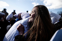 People attend the International Pillow Fight Day at Washington Square Park in New York, April 5, 2014. For the sixth year in a row, in more than 100 cities around the world to take part in the event. VIEWPRESS/Kena Betancur