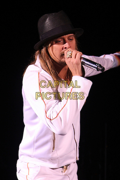 KID ROCK.Performs live in concert at the Carling Apollo in Hammersmith, London, England, UK, November 30th 2008..music live on stage gig half length black hat  white tracksuit top jacket zip up belt ring necklace microphone buffalo head belt buckle beard facial hair .CAP/MAR.©Martin Harris/Capital Pictures