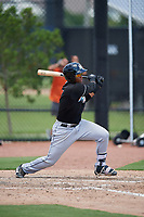 GCL Marlins third baseman Christopher Rodriguez (7) follows through on a swing during a game against the GCL Astros on August 5, 2018 at FITTEAM Ballpark of the Palm Beaches in West Palm Beach, Florida.  GCL Astros defeated GCL Marlins 2-1.  (Mike Janes/Four Seam Images)