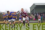 Scartaglin's Fred O'Connor gets the ball past Michael Fehilly of Diarmuid Mathunas, Cork in the Munster Novice Final last Sunday in Knockaderry.