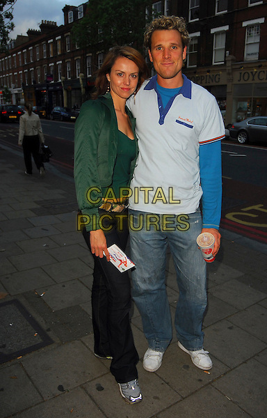 "BEVERLEY TURNER & JAMES CRACKNELL.""Once in a Lifetime: The Extraordinary Story of the New York Cosmos"" - VIP screenng, Screen On The Green, London, UK..May 15th, 2006.Ref: CAN.full length jeans denim green jacket blue.www.capitalpictures.com.sales@capitalpictures.com.©Capital Pictures"