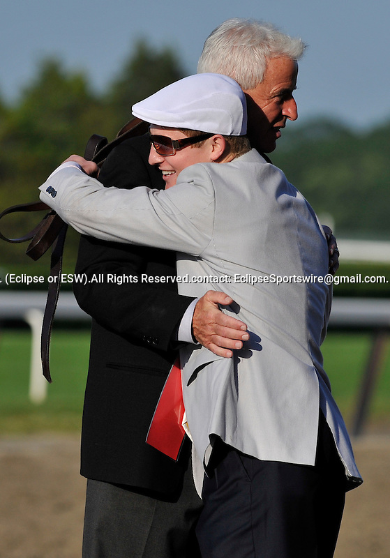 09 June 06: Trainer Nick Zito hugs Summer Bird's assistant trainer after Summer Bird wins the 141st running of the grade 1 Belmont Stakes for three year olds at Belmont Park in Elmont, New York.