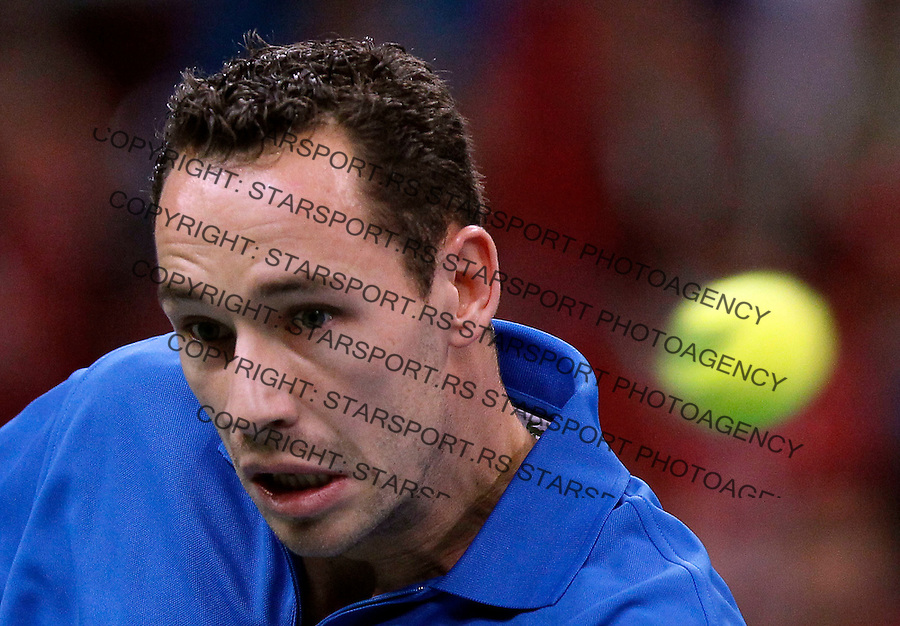 Michael Llodra of France returns a ball to Viktor Troicki of Serbia during their Davis Cup Final match in Belgrade, Serbia, Sunday, Dec.5, 2010..(Srdjan Stevanovic/Starsportphoto ©)