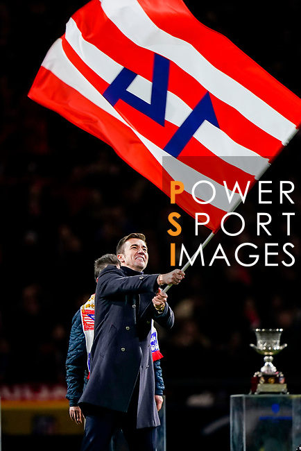 Former captain of Atletico de Madrid Gabriel Fernandez Arenas, Gabi, waves the flag with his Atletico de Madrid jersey number #14 as he attends a tribute in his honor after the La Liga 2018-19 match between Atletico de Madrid and RCD Espanyol at Wanda Metropolitano on December 22 2018 in Madrid, Spain. Photo by Diego Souto / Power Sport Images