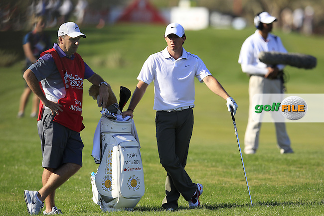Rory McIlroy (NIR) and caddy J.P.Fitzgerald wait to play his 2nd shot on the 14th hole during Friday's Round 2 of the Abu Dhabi HSBC Golf Championship at Abu Dhabi Golf Club, 18th January 2013 (Photo Eoin Clarke/www.golffile.ie)