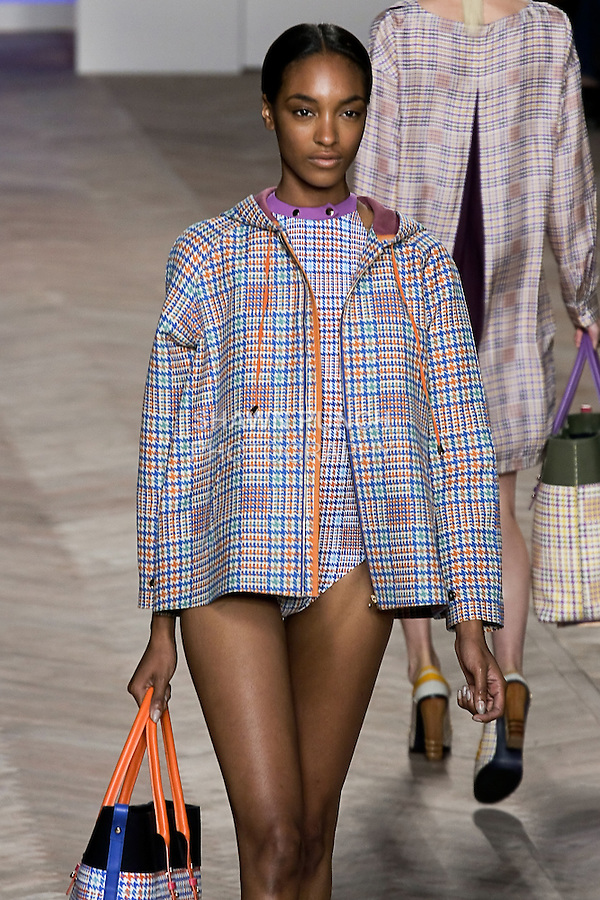 Jourdan Dunn walks the runway in a orange/blue glen plaid cotton zip-front hooded jacket, and orange/blue glen plaid one-piece bathing suit with purple trim, by Tommy Hilfiger for the Tommy Hilfiger Spring 2012 Pop Prep Collection, during Mercedes-Benz Fashion Week Spring 2012.