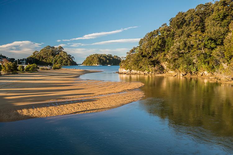 Evening view of the golden sands of Kaiteriteri Beach, Nelson New Zealand