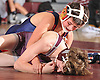 Jake Schneider of MacArthur, top, battles Greg Gibbons of Mepham at 99 pounds during a Nassau County varsity wrestling match at Mepham High School on Wednesday, Jan. 11, 2017. Schneider won the bout by major decision.