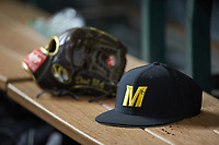 A Missouri Tigers cap sits on the bench near a Rawlings glove during the game against the Texas Longhorns in game eight of the 2020 Shriners Hospitals for Children College Classic at Minute Maid Park on March 1, 2020 in Houston, Texas. The Tigers defeated the Longhorns 9-8. (Brian Westerholt/Four Seam Images)