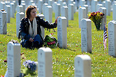 An unidentified woman cries and touches a gravestone in Section 60 of Arlington National Cemetery on Veteran's Day, in Arlington, Virginia, USA, 11 November 2012. United States President Barack Obama visited Section 60, 11 November, which is the final resting place for the majority of casualties at Arlington National Cemetery that died from Operation Iraqi Freedom in Iraq and Operation Enduring Freedom in Afghanistan..Credit: Michael Reynolds / Pool via CNP