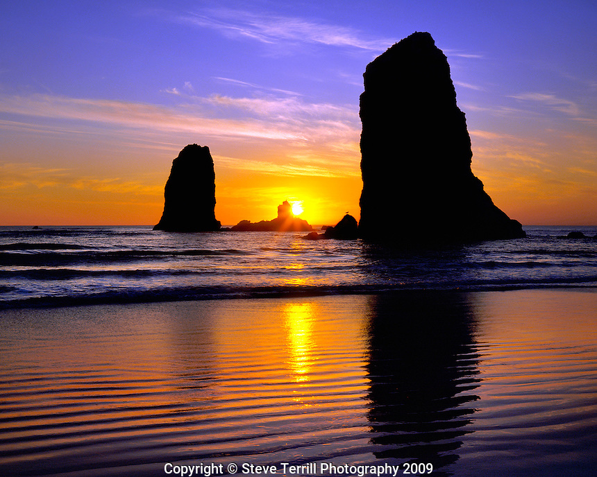 The Needles rock formations at sunset along Cannon Beach, Oregon