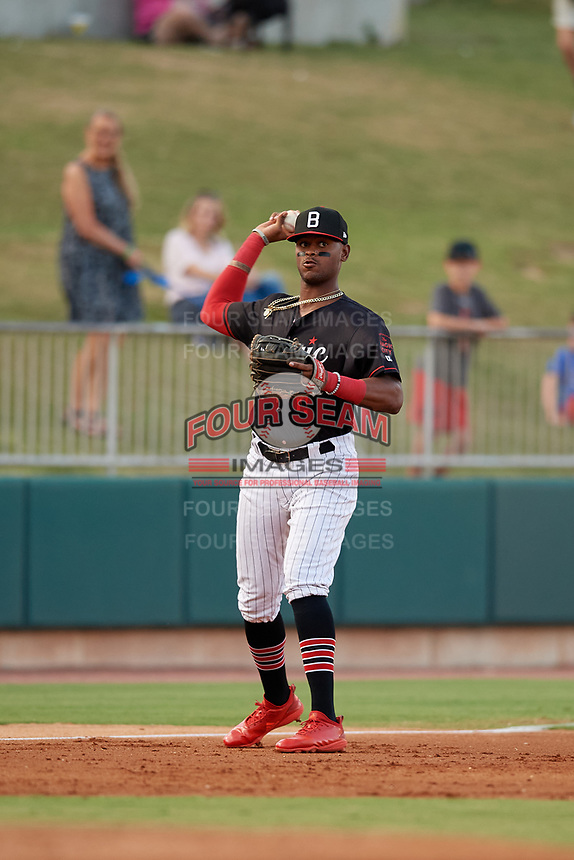 Birmingham Barons third baseman Ti'Quan Forbes (10) throws to first base during a Southern League game against the Chattanooga Lookouts on July 24, 2019 at Regions Field in Birmingham, Alabama.  Chattanooga defeated Birmingham 9-1.  (Mike Janes/Four Seam Images)