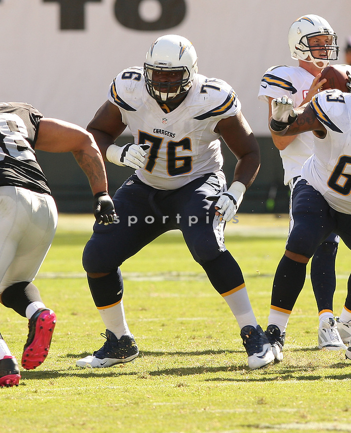 San Diego Chargers DJ Fluker (76) during a game against the Oakland Raiders on October 12, 2014 at O.co Coliseum in Oakland, CA. The Chargers beat the Raiders 31-28.