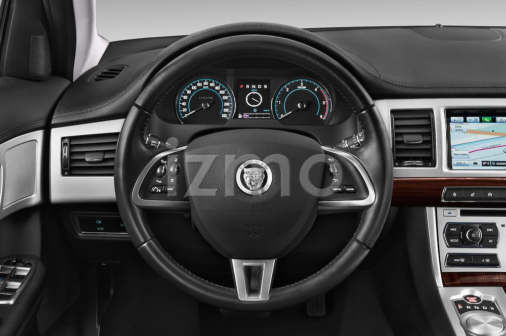 Car pictures of steering wheel view of a 2015 Jaguar XF 2.2D 163 auto 4 Door Sedan 2WD Steering Wheel
