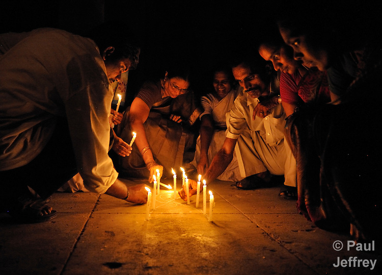 People infected by and affected by HIV and AIDS gather for a candlelight vigil in Guntur, Andhra Pradesh, India, to raise public awareness of the virus and the need to end stigma and discrimination against those living with it. Here they place their candles on the ground in the shape of the ribbon which has become the universal symbol for AIDS awareness.
