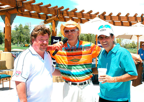 Glen Campbell, Alice Cooper and guest at the 9th Alice Cooper Golf Tournament in Scottsdale to benefit his Solid Rock Foundation Charity, May 2nd 2005. phoo by Chris walter/Photofeatures.
