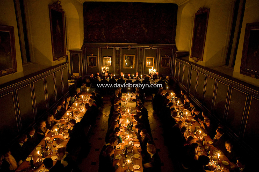 Students and Fellows (background) have dinner in the formal dinning hall at Magdalene College in Cambridge, United Kingdom, 11 March 2007.