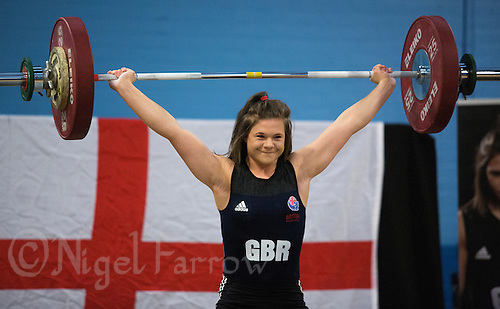 23 FEB 2014 - SMETHWICK, GBR - A smiling Rebekah Tiler (ENG / GBR) of Great Britain and England attempts to hold a lift during the women's 69kg category round at the 2014 English Weightlifting Championships at the Harry Mitchell Leisure Centre in Smethwick, Great Britain. Tiler, who though still only 15 years old is already considered a prospect. Her final total of 194kg makes her eligible for the England team for the 2014 Commonwealth Games (PHOTO COPYRIGHT &copy; 2014 NIGEL FARROW, ALL RIGHTS RESERVED)<br /> ==========================================<br /> USE WITH CARE - IMAGE FEATURES COMPETITOR UNDER  16 YEARS OLD<br /> ==========================================