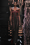 """Model walks runway in an embroidered black/bordeaux cut out silk charmeuse long sleeve dress from the Reem Acra Fall 2016 """"The Secret World of The Femme Fatale"""" collection, at NYFW: The Shows Fall 2016, during New York Fashion Week Fall 2016."""