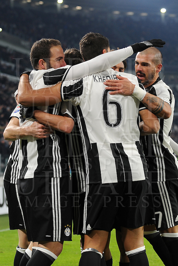 Calcio, Serie A: Juventus vs Bologna. Torino, Juventus Stadium, 8 gennaio 2017.<br /> Juventus' Gonzalo Higuain, left, celebrates with teammates after scoring during the Italian Serie A football match between Juventus and Bologna at Turin's Juventus Stadium, 8 January 2017. Juventus won 3-0.<br /> UPDATE IMAGES PRESS/Manuela Viganti