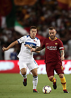 Calcio, Serie A: Roma - Atalanta, Stadio Olimpico, 27 agosto, 2018.<br /> Roma's captain Daniele De Rossi (r) in action with Atalanta's Mario Pasalic (l) during the Italian Serie A football match between Roma and Atalanta at Roma's Stadio Olimpico, August 27, 2018.<br /> UPDATE IMAGES PRESS/Isabella Bonotto