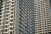 A housing block is built by the government to compensate farmers for their lost land in northern China.<br /> <br /> China is pushing ahead with a dramatic, history-making plan to move 100 million rural residents into towns and cities over six years &mdash; but without a clear idea of how to pay for the gargantuan undertaking or whether the farmers involved want to move.<br /> <br /> Moving farmers to urban areas is touted as a way of changing China&rsquo;s economic structure, with growth based on domestic demand for products instead of exporting them. In theory, new urbanites mean vast new opportunities for construction firms, public transportation, utilities and appliance makers, and a break from the cycle of farmers consuming only what they produce.<br /> <br /> Urbanization has already proven to be one of the most wrenching changes in China&rsquo;s 35 years of economic reforms. Land disputes rising from urbanization account for tens of thousands of protests each year.