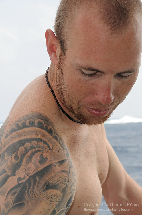 Gun Shui Bi, Green Island -- Nate proudly showing off his shark tattoo in between dives on the 'hammers'.
