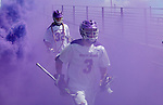 TD Ierlan (#3) enters through the purple haze as UAlbany Lacrosse defeats Vermont 14-4  in the American East Conference Championship game at Casey Stadium, May 5.