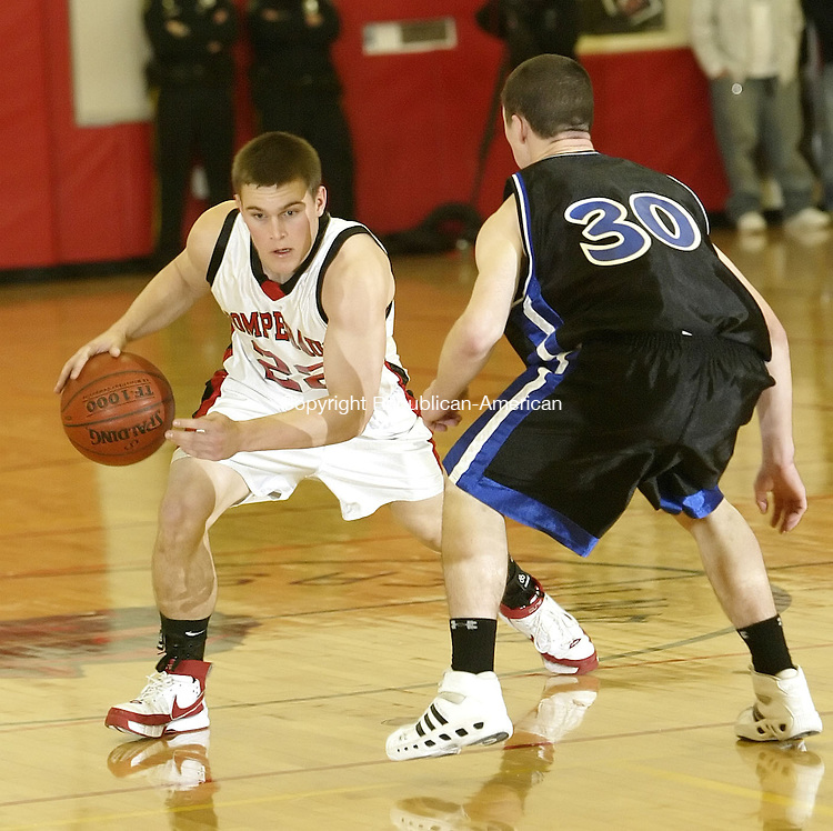 SOUTHBURY, CT, 01/02/08- 010208BZ10- Pomperaug's Chris Comeau (22) looks for room around Bunnell's Mike Groves (30) during their game at Pomperaug High School in Southbury Wednesday night.<br /> Jamison C. Bazinet Republican-American