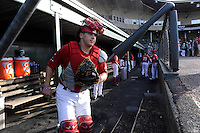 Catcher Jake Romanski (12) of the Greenville Drive steps onto the field as he is introduced before a game against the Asheville Tourists on Tuesday, July 1, 2014, at Fluor Field at the West End in Greenville, South Carolina. Asheville won, 5-2. (Tom Priddy/Four Seam Images)
