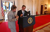 United States President George W. Bush prepares for his Thursday night speech about the Department of Homeland Security with Karen Hughes, Counselor to the President, on Thursday afternoon June 6, 20012 in the Cross Hall of the White House in Washington, DC.<br /> Mandatory Credit: Eric Draper / White House via CNP