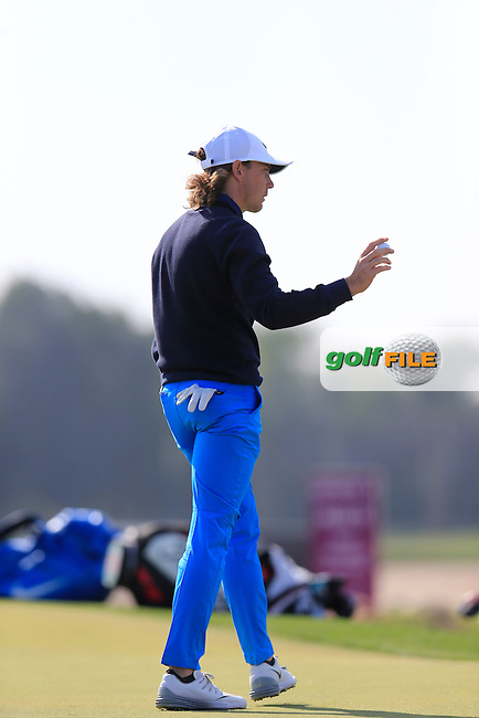 Tommy Fleetwood (ENG) sinks his putt on the 10th green during Saturday's Final Round of the 2016 Commercial Bank Qatar Masters held at the Doha Golf Club, Doha, Qatar. 30th January 2016.<br /> Picture: Eoin Clarke | Golffile<br /> <br /> <br /> All photos usage must carry mandatory copyright credit (&copy; Golffile | Eoin Clarke)