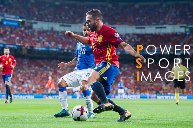 Daniel Carvajal (front) of Spain fights for the ball with Lorenzo Insigne (back) of Italy during their 2018 FIFA World Cup Russia Final Qualification Round 1 Group G match between Spain and Italy on 02 September 2017, at Santiago Bernabeu Stadium, in Madrid, Spain. Photo by Diego Gonzalez / Power Sport Images
