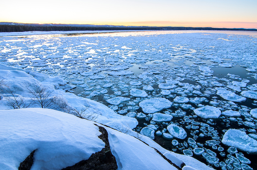 The end of a beautiful winter day on Lake Superior. Taken from Little Presque Isle with pancake ice along the shoreline. Marquette, MI