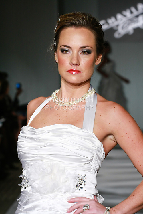 Model walks the runway in a Chaviano Couture Madison Alyse wedding dress by Annette Thurmon, during the Wedding Trendspot Spring 2011 Press Fashion show, October 17, 2010.