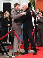 07 January 2019 - Hollywood, California - Bradley Cooper, Sam Elliott . Sam Elliott Hand And Footprint Ceremony held at TCL Chinese Theatre. <br /> CAP/ADM/BT<br /> &copy;BT/ADM/Capital Pictures