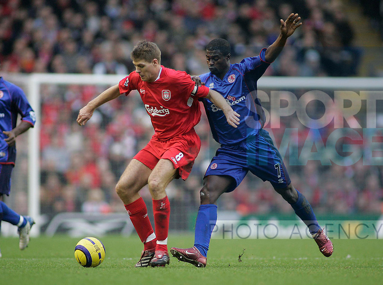 Liverpool's Steven Gerrard challenged by  Middlesbrough's George Boateng in thier Premier League match at Anfield, Liverpool, 10 November, 2005..Pic Sportimage/Simon Bellis