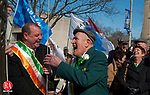 """WATERBURY, CT 17 MARCH 2013--031713JS09--Waterbury Irish Mayor of the Day, Patrick """"Bob"""" O'Rourke, 79, former vice president of the city's Ancient Order of Hibernians, shares a laugh with Waterbury Mayor Neil M. O'Leary, left, as they raise the Irish flag during a ceremony Sunday at Waterbury City Hall..Jim Shannon Republican-American."""