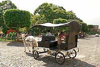 Horse and carriage in Antigua, Guatemala. Antigua is a UNESCO World heritage site...