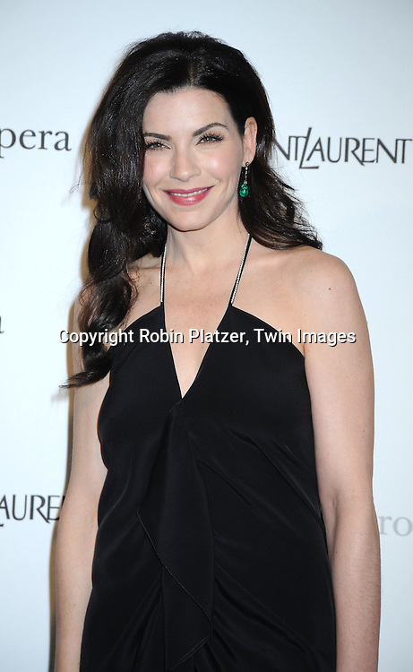 "actress Julianna Margulies in Yves Saint Laurent black dress attending The Metropolitan Opera's Gala Premiere of ""Armida"" on April 12, 2010 at The Metropolitan Opera House in New York City."