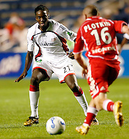 New England Revolution midfielder Shalrie Joseph (21) defends against Chicago Fire midfielder Brian Plotkin (16).  The Chicago Fire defeated the New England Revolution 2-1 in the quarterfinals of the U.S. Open Cup at Toyota Park in Bridgeview, IL on August 23, 2006...