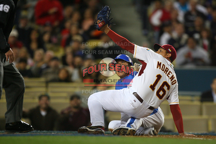 Jin Young Lee of Korea and Orber Moreno of Venezuela during a game at the World Baseball Classic at Dodger Stadium on March 21, 2009 in Los Angeles, California. (Larry Goren/Four Seam Images)