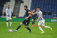 Borja Baston of Swansea City battles with Jonathan Hogg of Huddersfield Town during the Sky Bet Championship match between Huddersfield Town and Swansea City at The John Smith's Stadium in Huddersfield, England, UK. Tuesday 26 November 2019