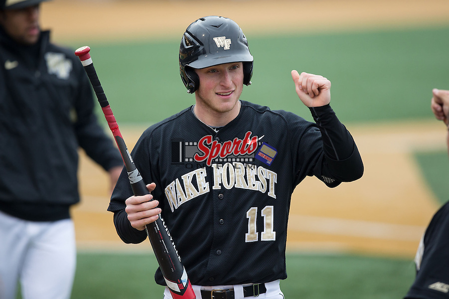 Jonathan Pryor (11) of the Wake Forest Demon Deacons is congratulated by teammates after scoring a run against the Towson Tigers at Wake Forest Baseball Park on March 1, 2015 in Winston-Salem, North Carolina.  The Demon Deacons defeated the Tigers 15-8.  (Brian Westerholt/Sports On Film)