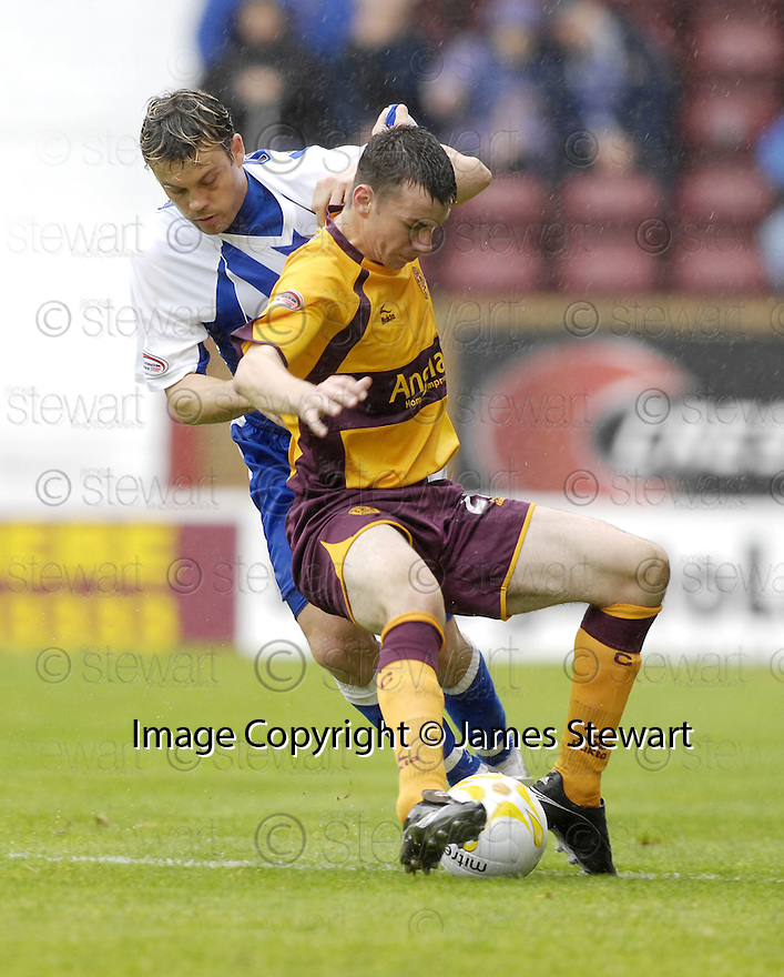 18/08/2007       Copyright Pic: James Stewart.File Name : sct_jspa10_motherwell_v_kilmarnock.DAVID FERNANDEZ AND PAUL QUINN CHALLENGE.James Stewart Photo Agency 19 Carronlea Drive, Falkirk. FK2 8DN      Vat Reg No. 607 6932 25.Office     : +44 (0)1324 570906     .Mobile   : +44 (0)7721 416997.Fax         : +44 (0)1324 570906.E-mail  :  jim@jspa.co.uk.If you require further information then contact Jim Stewart on any of the numbers above........