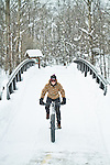Amy Kopischke riding the core trail through downtown Steamboat Springs in the Winter.
