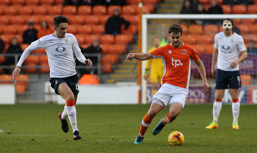 Blackpool's Andy Taylor gets away from Luton Town's Alex Gilliead<br /> <br /> Photographer David Shipman/CameraSport<br /> <br /> The EFL Sky Bet League Two - Blackpool v Luton Town - Saturday 17th December 2016 - Bloomfield Road - Blackpool<br /> <br /> World Copyright &copy; 2016 CameraSport. All rights reserved. 43 Linden Ave. Countesthorpe. Leicester. England. LE8 5PG - Tel: +44 (0) 116 277 4147 - admin@camerasport.com - www.camerasport.com